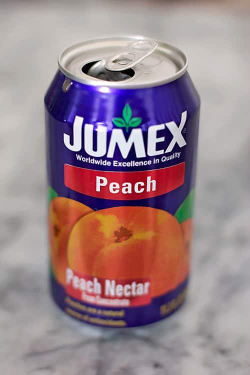 Champagne, orange juice, peach nectar, and a few slices of fresh peach ...