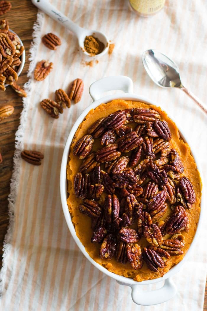 Lightened Up Sweet Potato Casserole- this recipe is VEGAN, dairy-free, and gluten free but still a VERY yummy and healthy addition to your thanksgiving table!