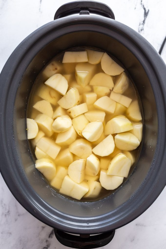 chunks of potato in a slow cooker