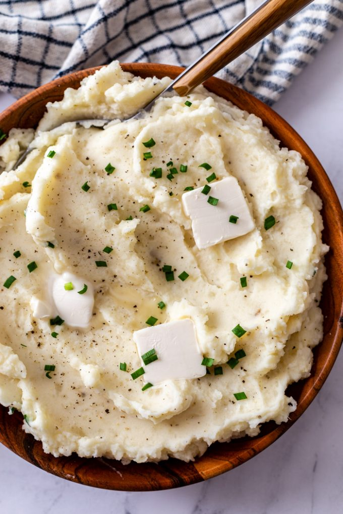 mashed potatoes topped with pats of butter