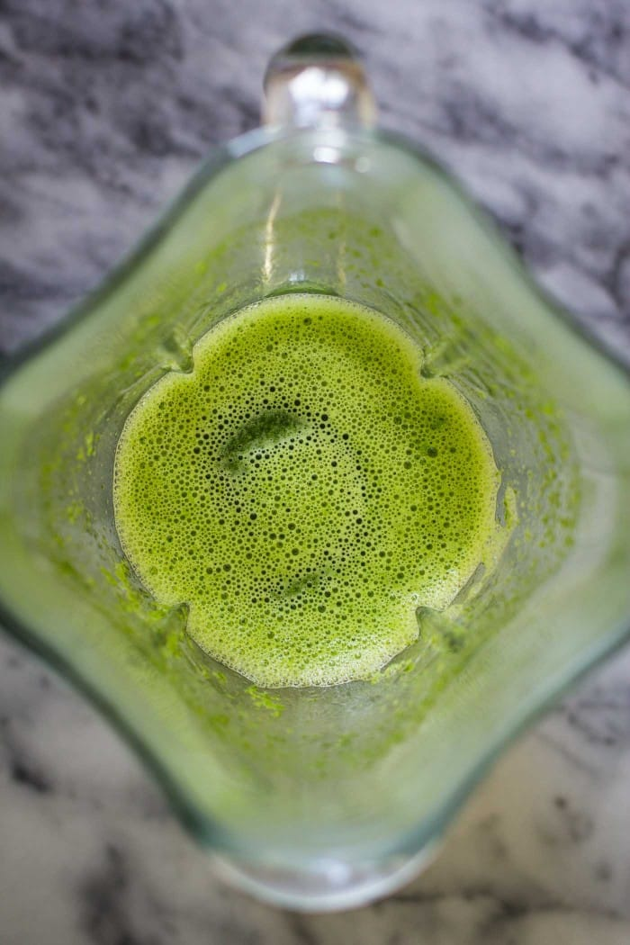 Strawberry Banana Green Smoothie- the smoothie recipe is SO easy to throw together, just 5 ingredients, and it makes for the PERFECT on the go breakfast! | bbritnell.com