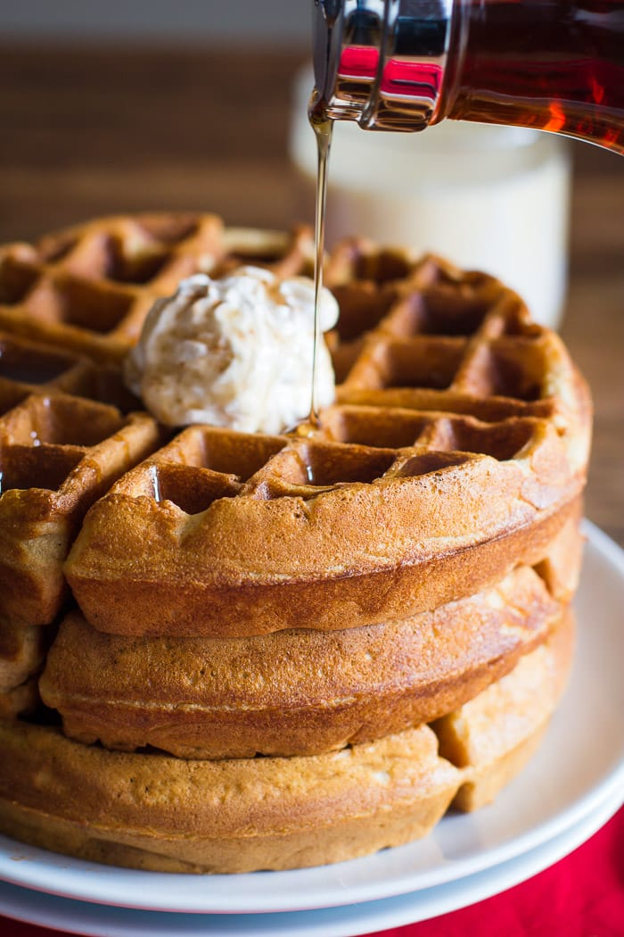 Egg Nog Waffles- these are a fun variation on traditional Belgium waffles and topped with a super yummy Gingerbread Whipped Cream! Perfect for the Holidays!