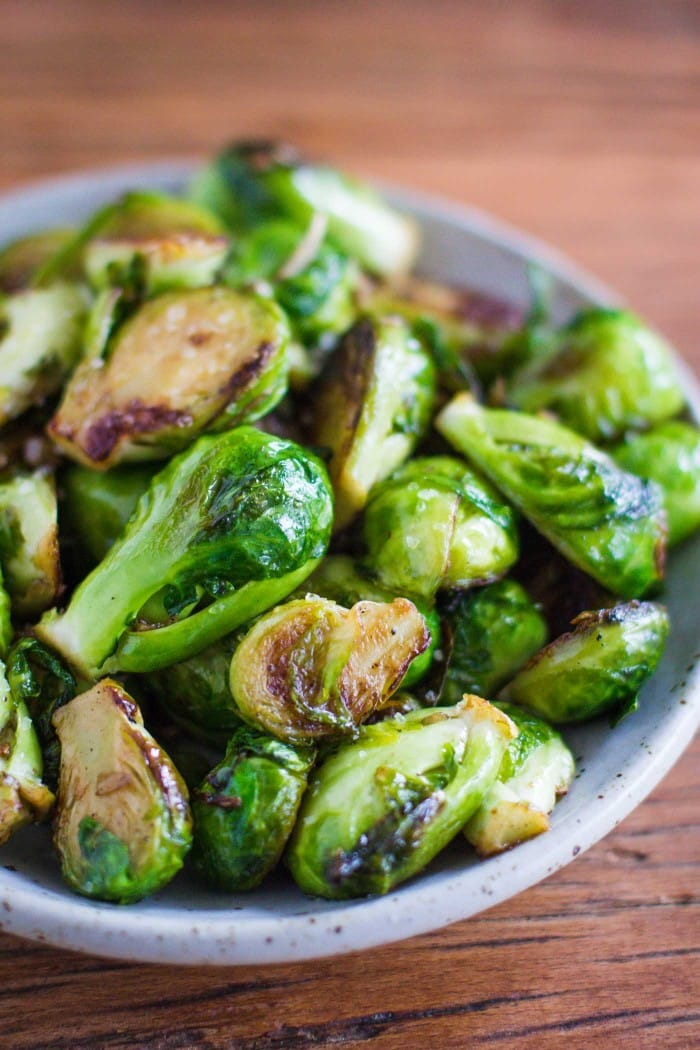 Sea Salt & Garlic Brussels Sprouts- this recipe is SO easy to throw together, healthy, and SO so delicious. A great recipe for weeknight dinners! |bbritnell.com