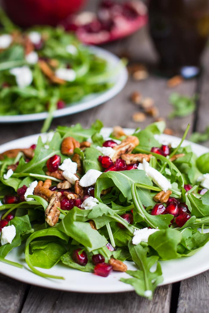Winter Pomegranate Salad- this recipe is perfect for the holidays. It's light and healthy with a yummy ORANGE VINAIGRETTE.