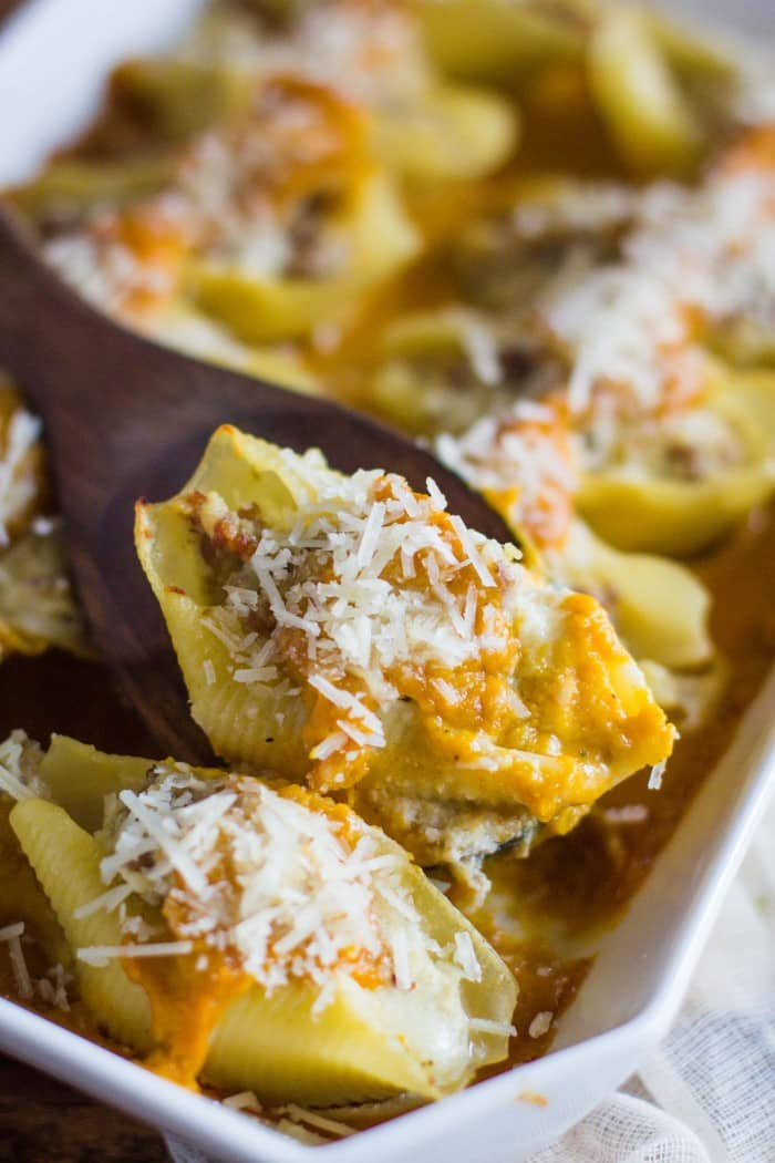 Stuffed Shells with Butternut Squash Sauce- this recipe is hearty and delicious and a fun alternative to traditional stuffed shells. They also freeze great!