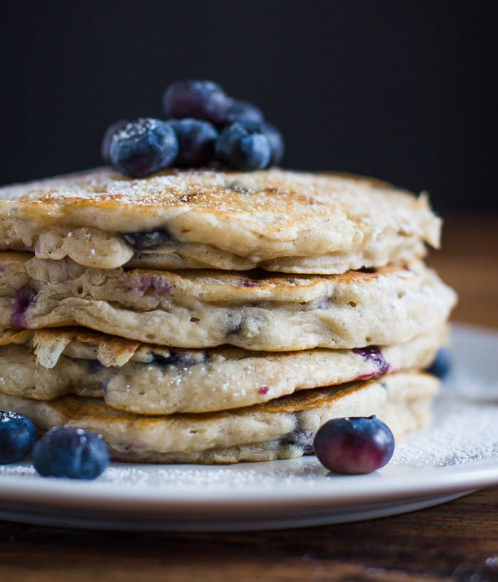 VEGAN Blueberry Pancakes- this pancake recipe is easy to throw together and results in the FLUFFIEST and yummiest breakfast!