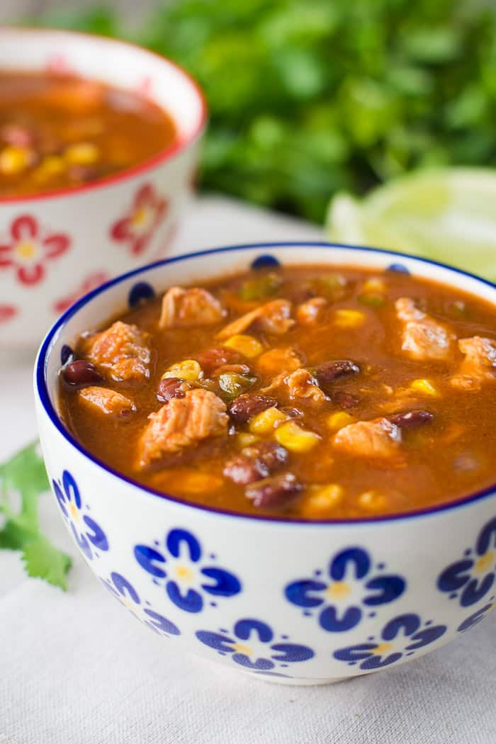 Slow Cooker Taco Soup- this recipe is ridiculously easy to make, light and healthy, and a true family favorite!!