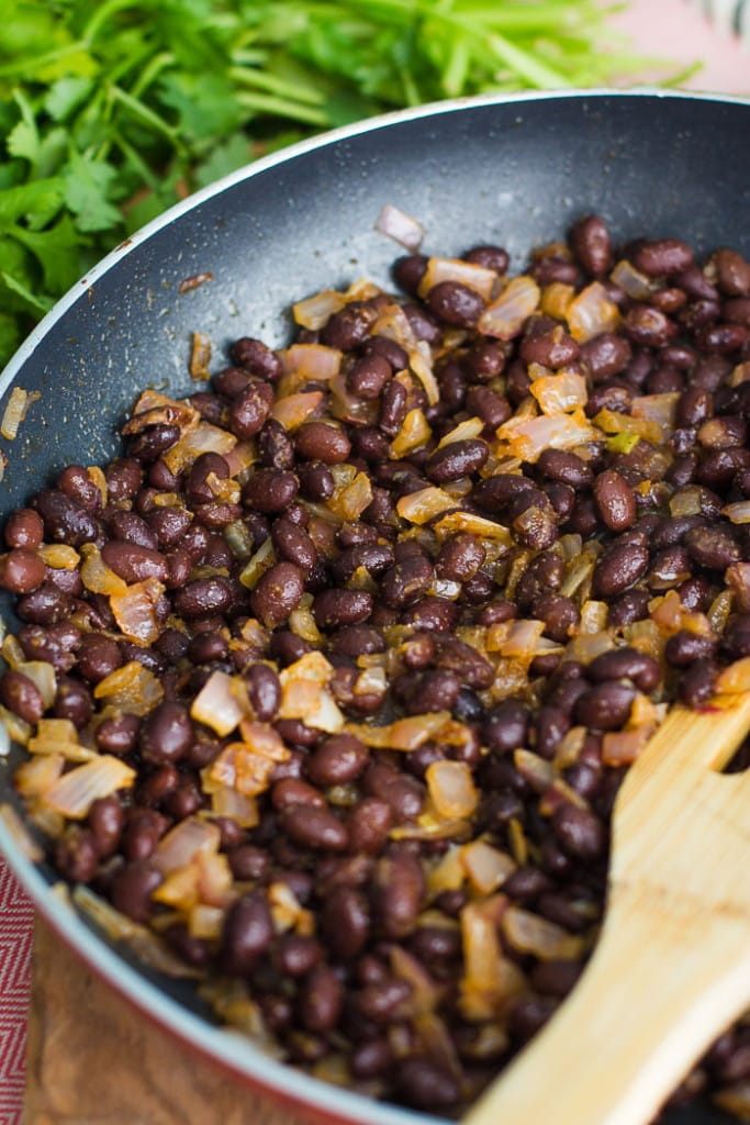 black beans and onion in a skillet