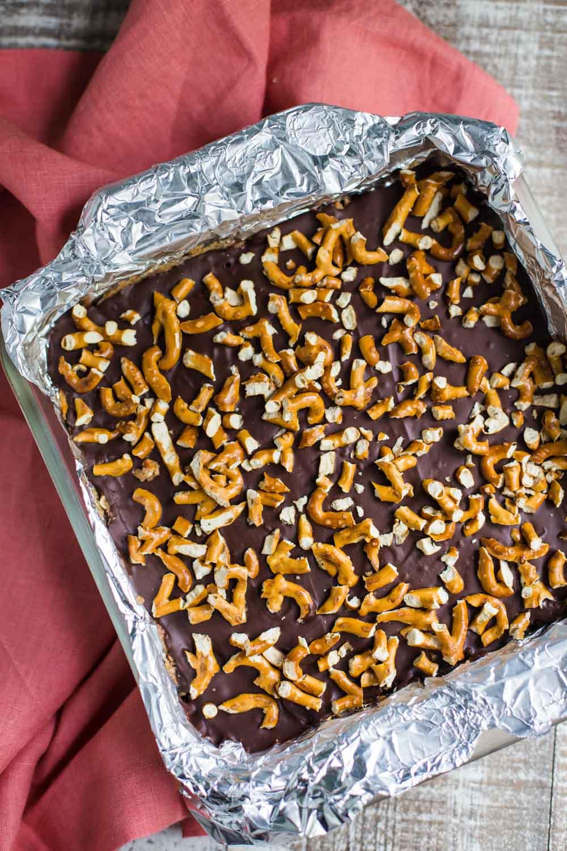 Almond Butter & Dark Chocolate Pretzel Bars- VEGAN dessert that's NO bake and easy to make!!