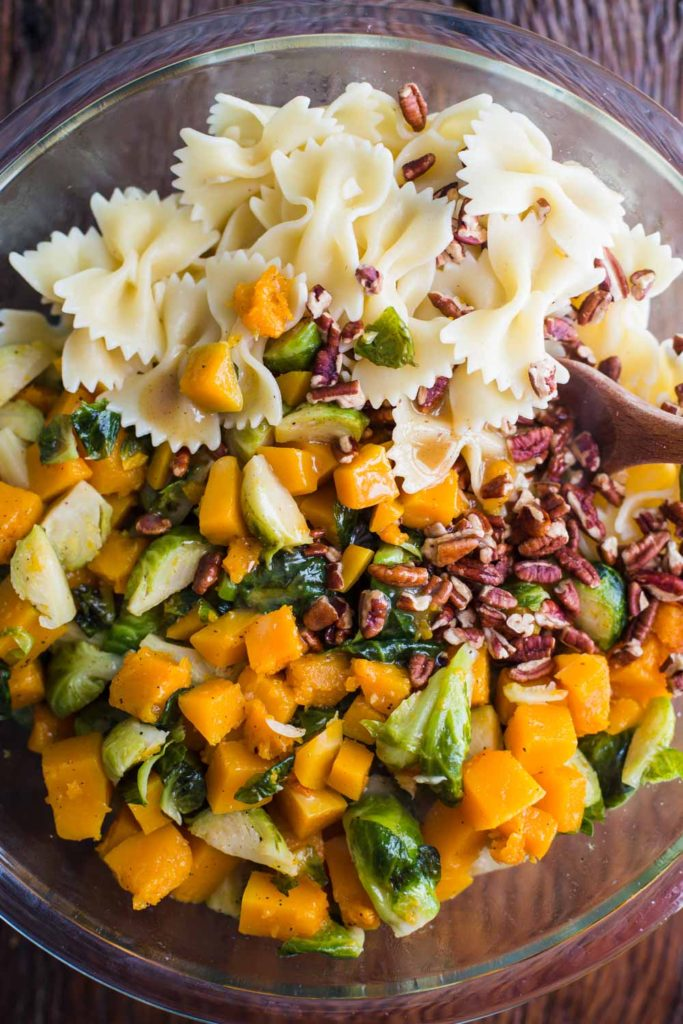 Fall Inspired Pasta Salad- this pasta salad is filled with butternut squash, Brussels sprouts, and a yummy apple cider dressing. Vegan and delicious!