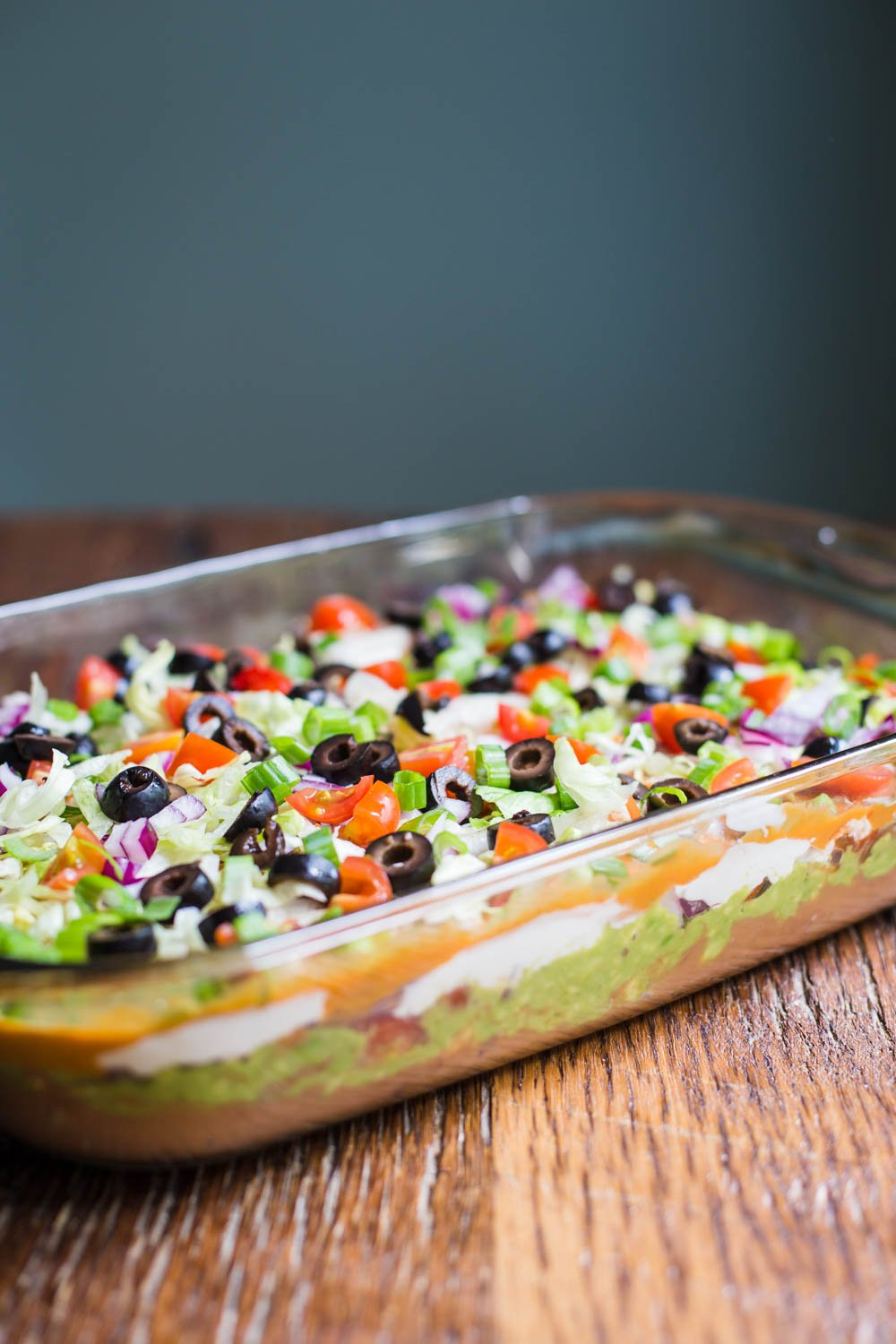 Vegan Seven Layer Dip- this party appetizer is completely vegan, easy to throw together, and a party dish that everyone will enjoy!