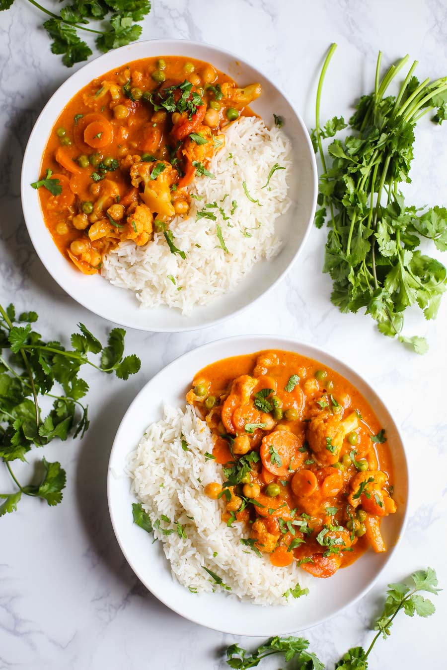 Loaded Veggie Tikka Masala- this vegan tikka masala is easy to make, FULLY vegan, and loaded with delicious vegetables and chickpeas!