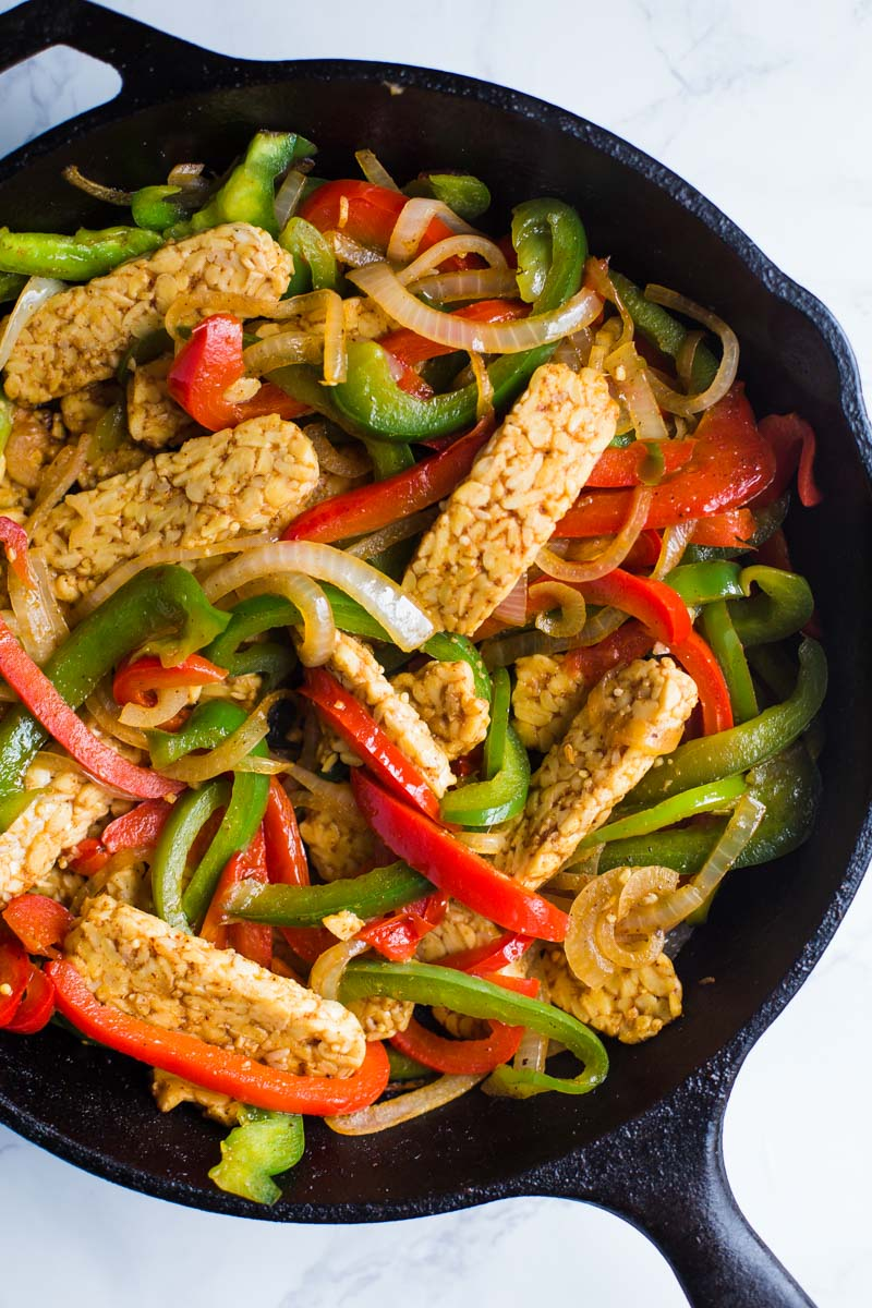 Easy Tempeh Fajitas- These tempeh fajitas are completely VEGAN and vegetarian, and easy to make. Something the whole family will love for dinner!
