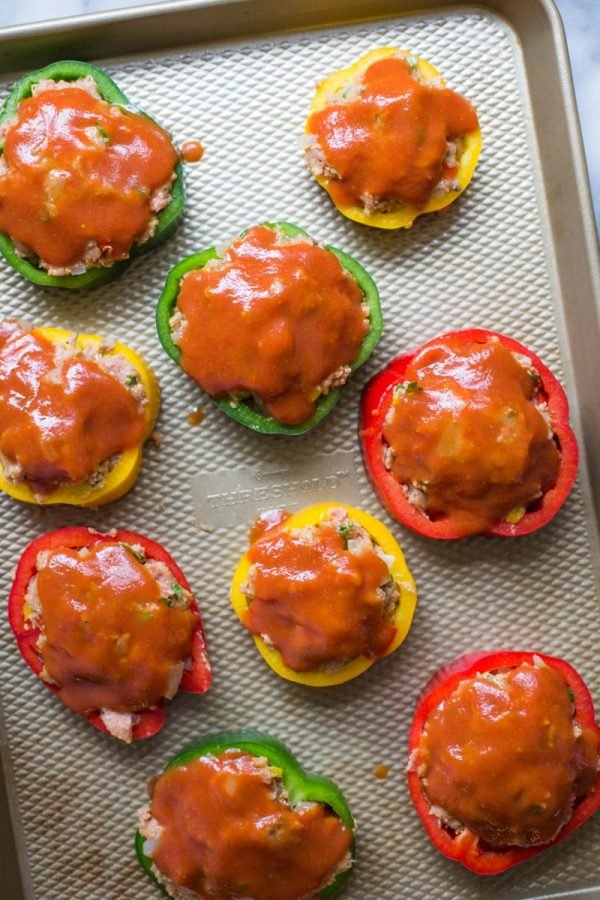 meatloaf inside of multi colored bell pepper rings