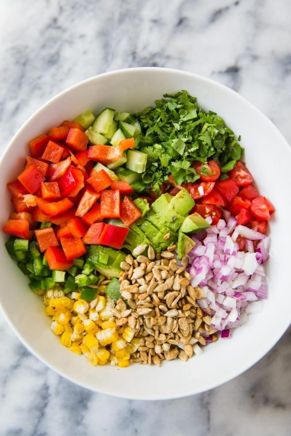 Grilled Corn Salad recipe- this is the perfect side for any party or summer dinner! It's loaded with fresh corn, cucumber, tomatoes and all of the flavors of summer.