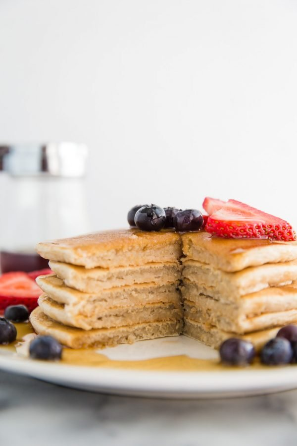 Easy Vegan Pancakes Recipe can be whipped together in just 10 minutes and makes for the perfect vegan breakfast! They freeze well which makes them perfect for meal prep.