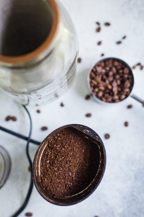 coffee beans being ground up in a coffee grinder