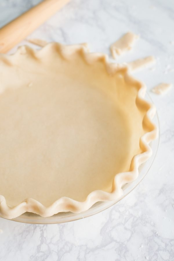 Coconut Oil Pie Crust- this easy to make pie crust is VEGAN and DAIRY FREE and the BEST pie crust you will ever have!!