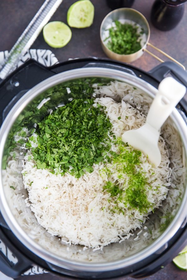 Instant Pot Cilantro Lime Rice- this simple recipe shows you how to make fluffy and delicious cilantro lime rice directly in your pressure cooker.