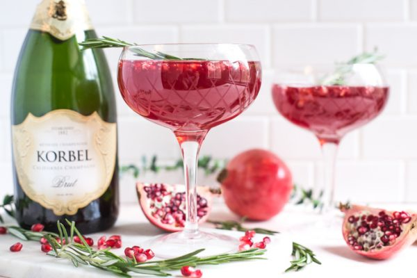 Pomegranate Champagne Cocktail- this holiday cocktail is easy to make in either a single glass or a pitcher to serve a crowd!
