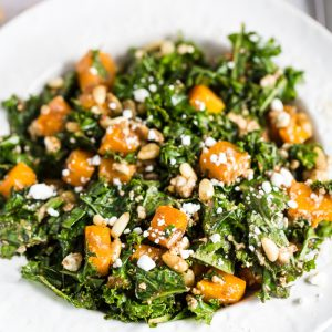 kale salad with butternut squash on top