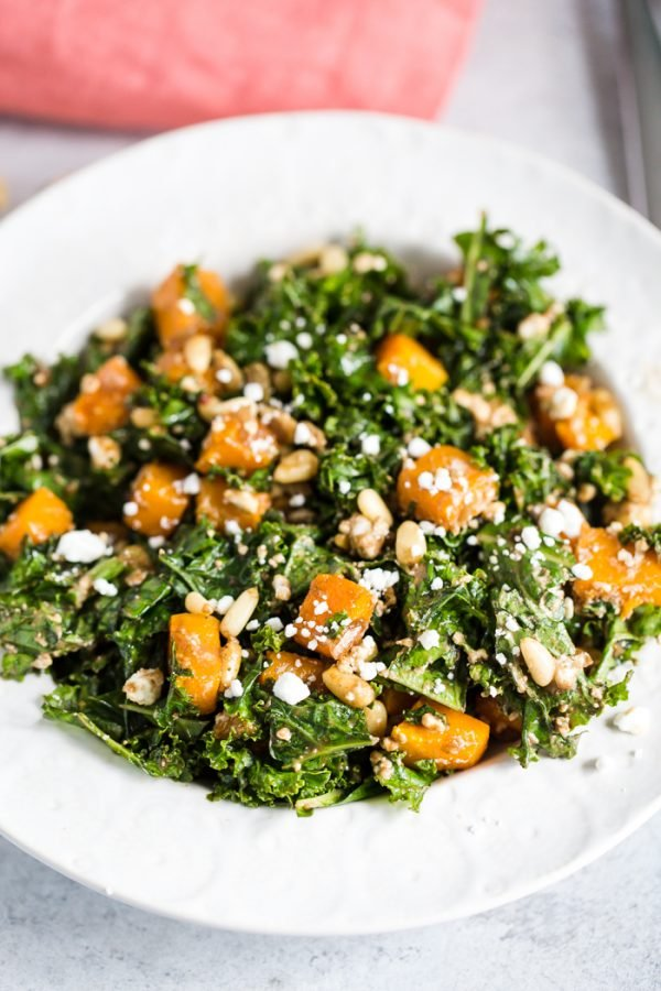 Warm Kale Salad- this vegetarian kale salad makes for the perfect winter meal or side dish. Topped with goat cheese, pine nuts, and a delicious balsamic dressing!