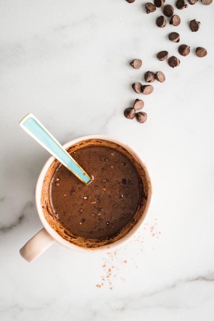 chocolate cake batter in a mug