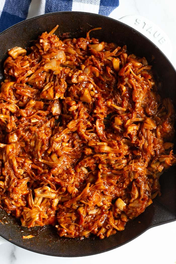 jackfruit pulled pork in a cast iron skillet and covered in bbq sauce