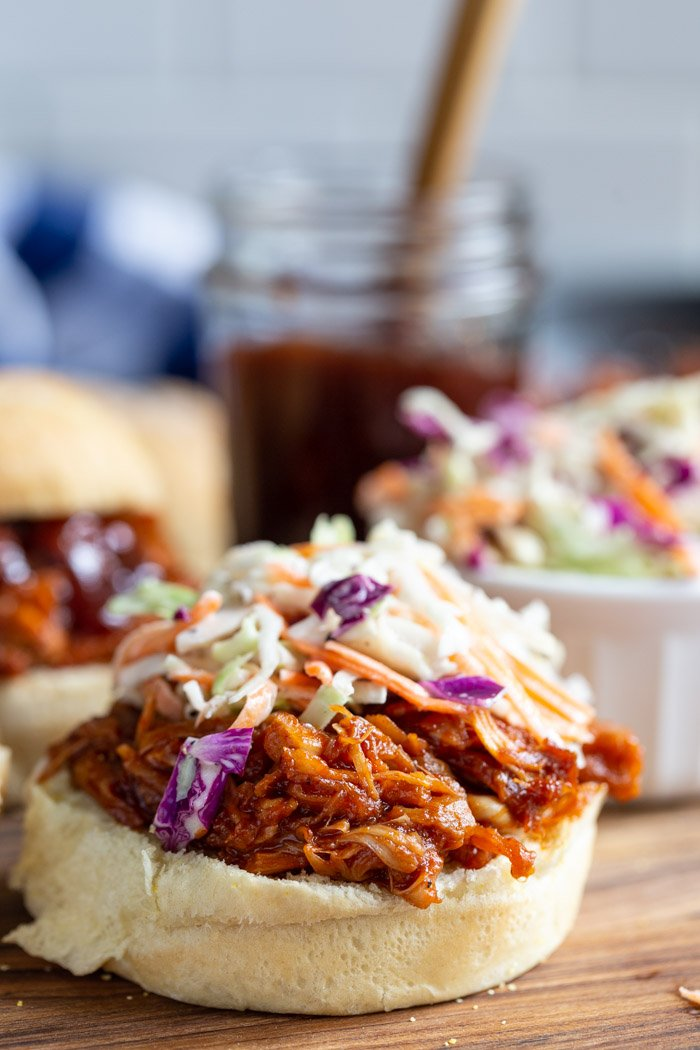 jackfruit pulled pork on a bun and topped with bbq sauce and coleslaw