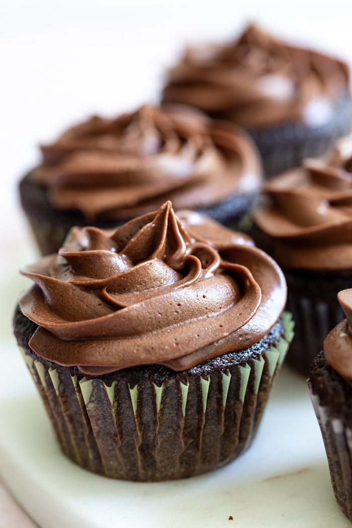 EASY Vegan Chocolate Cupcakes- this vegan cupcake recipe comes together in just ONE big bowl and bake in right at 20 minutes! So decadent and fluffy and no one will ever even know they're vegan! #cupcake #cupcakes #vegan #baking