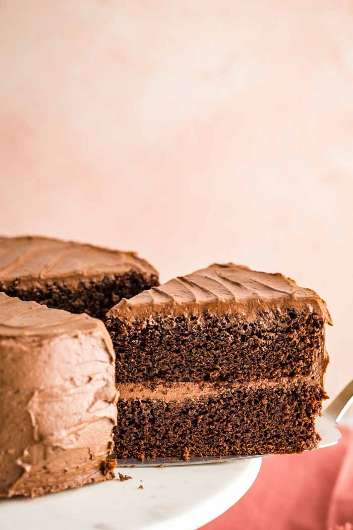 This is THE BEST Vegan Chocolate Cake Recipe that you will ever find! It's rich and decadent and perfect for holiday baking. My favorite vegan cake. #cake #vegan #baking #chocolatecake