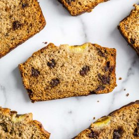 Chocolate Chip Vegan Banana Bread- this recipe comes together in ONE BOWL and seriously tastes amazing! The perfect vegan breakfast or snack. #bread #vegan #baking