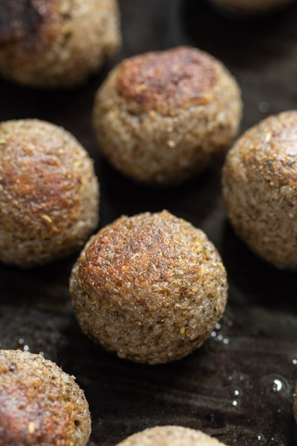 browned vegan meatballs in a black cast iron skillet. how to make vegan meatballs