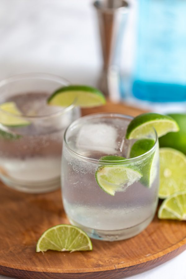 gin and tonic with lime wedges