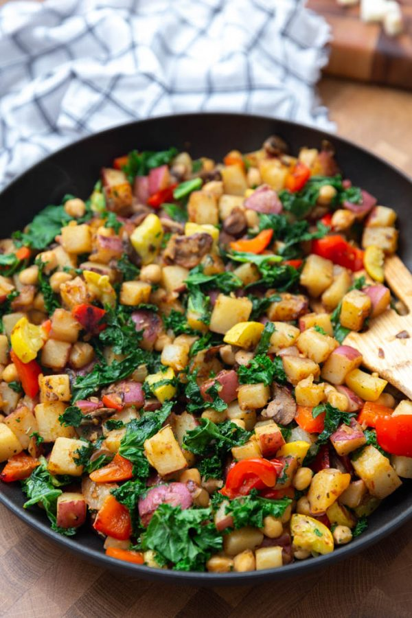 up close shot of a vegan breakfast hash with potatoes, kale, and veggies
