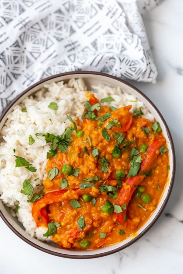 coconut lentil curry on white rice in a bowl
