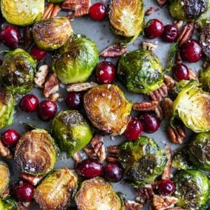 sheet pan filled with roasted brussels sprouts, fresh cranberries and roasted pecans