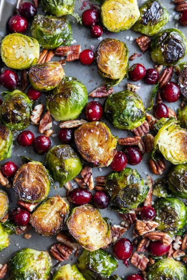 cranberry brussels sprouts on a baking tray with sea salt on top