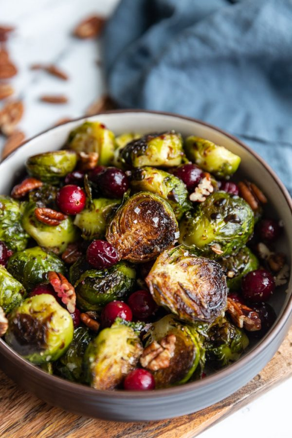 roasted brussels sprouts and cranberries in a bowl with sea salt on top