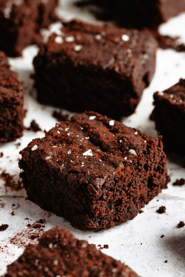 vegan brownies with sea salt on a white background
