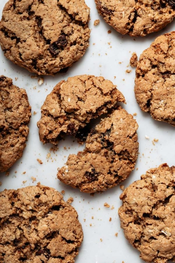 vegan oatmeal cookies with raisin on a white background