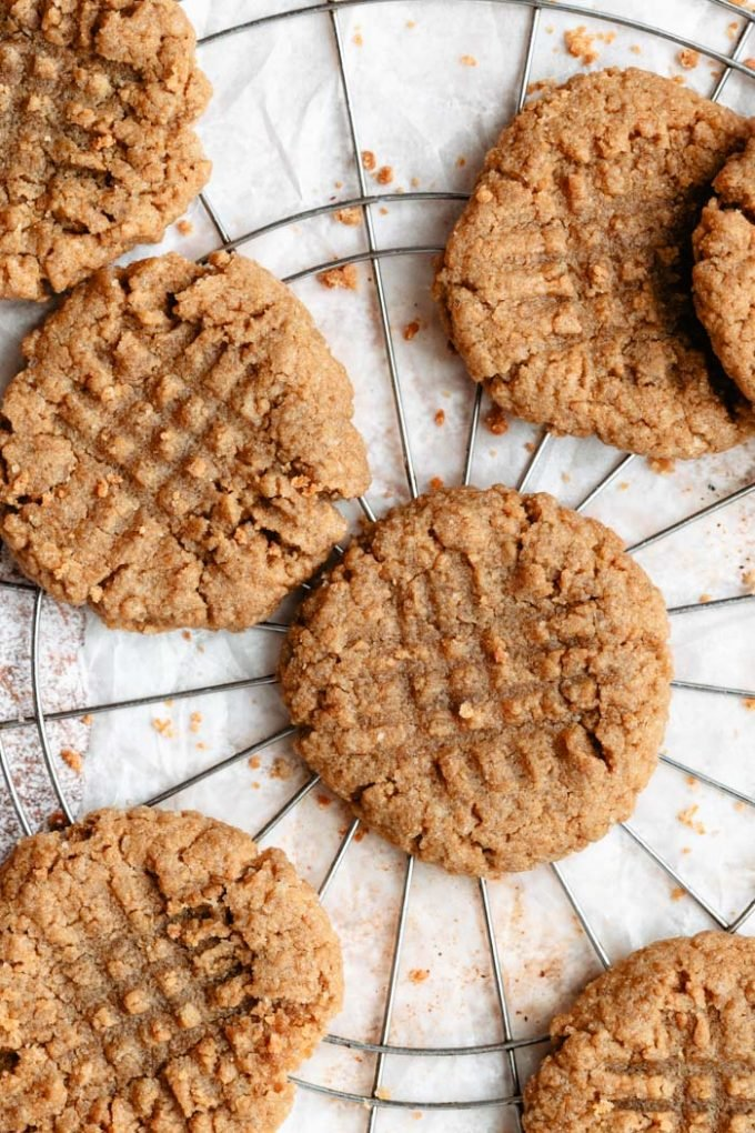 vegan peanut butter cookies on a white background and cooling rack