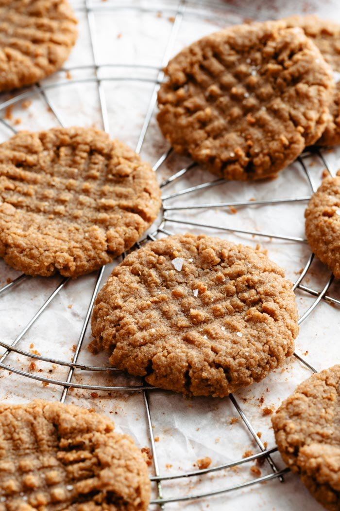 vegan peanut butter cookies on a white background and a cooling rack