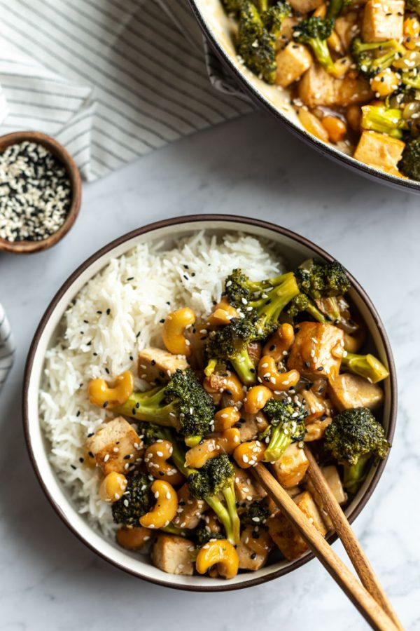 cashew tofu stir fry over white rice in a bowl