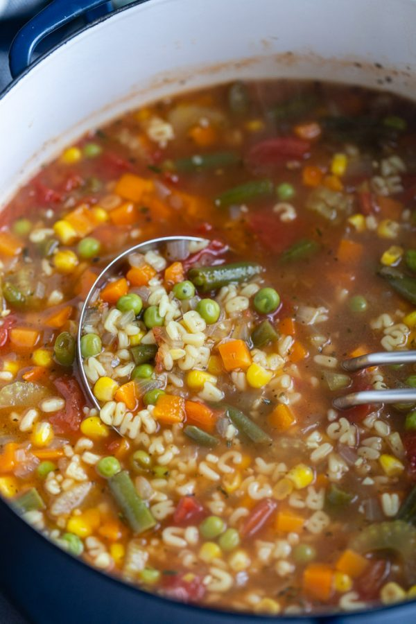 up close shot of vegetable alphabet soup in a pot