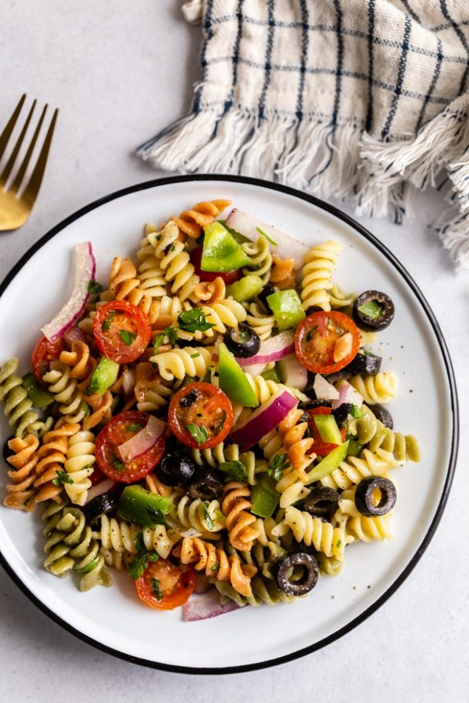 shot of pasta salad with tri color past spirals and veggies