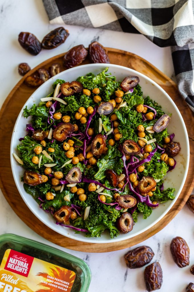date kale salad with purple cabbage, chickpeas, and almonds