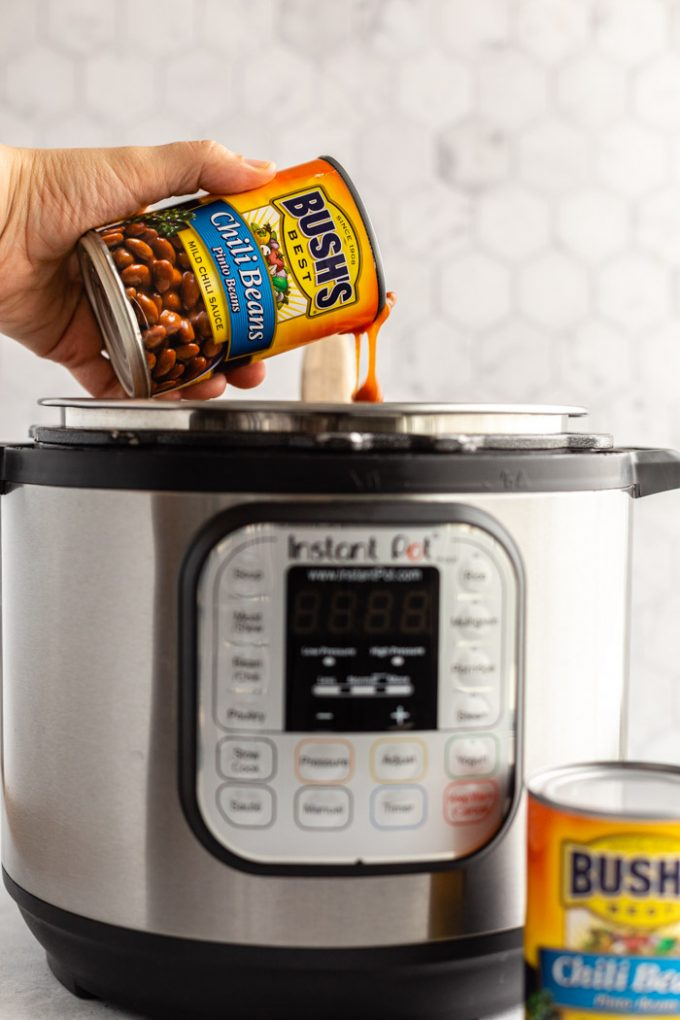can of bush's chili pinto beans being poured into an instant pot