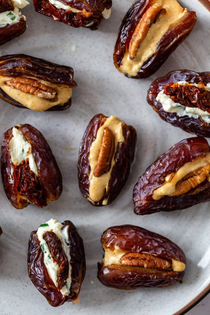 dates stuffed with cream cheese, pecans and others stuffed with sun dried tomatoes