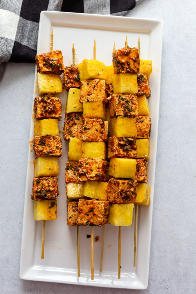 grilled skewers with tofu and pineapple on a white plate